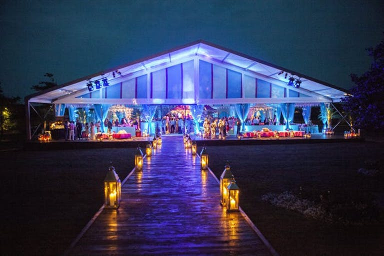 Transparent Party Tent With Blue Uplighting | PartySlate