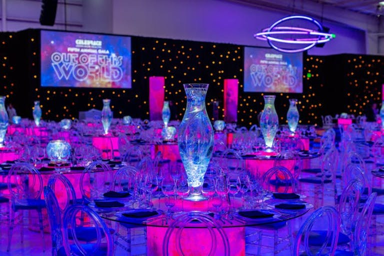 Galaxy-Themed Party With a Pink and Purple Neon Glowing Room and Glow-in-the-Dark Centerpieces | PartySlate