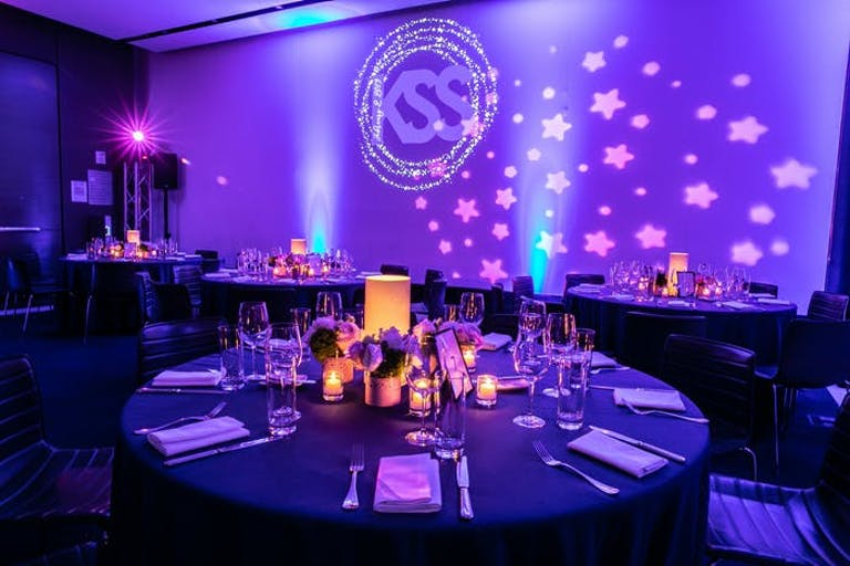 Celestial-Themed Bat Mitzvah Party in a Purple Uplit Room With Neon Orange Centerpieces | PartySlate