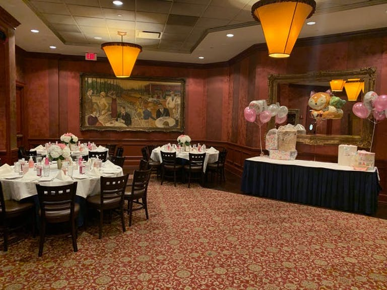 The Clubhouse Oak Brook baby shower venue in Chicago with red walls and red carpet with yellow lighting