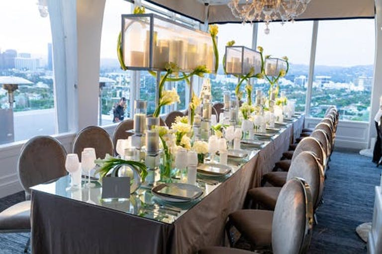 Tablescape With Candle Light, Calla Lilies, and Dramatic City Views | PartySlate