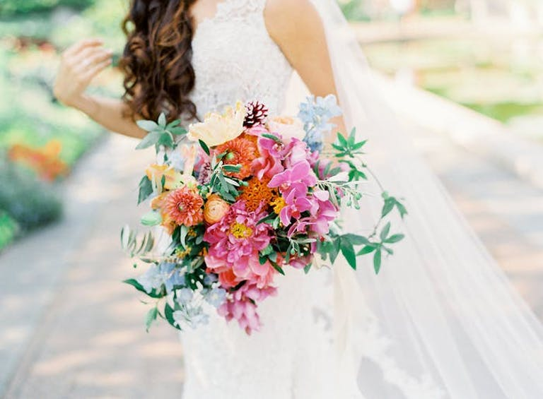 pink, orange, yellow bouquet with greenery.