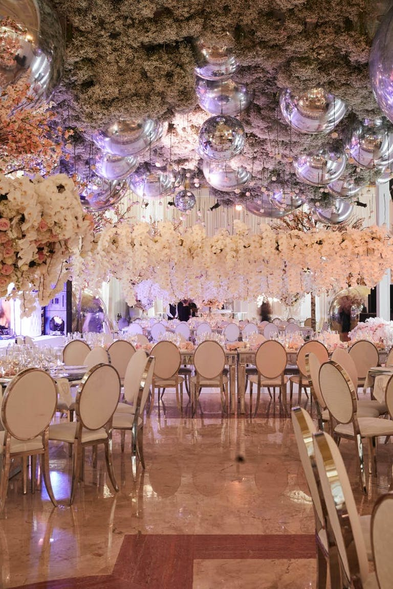 A room covered with ceiling florals and raised floral ceterpieces