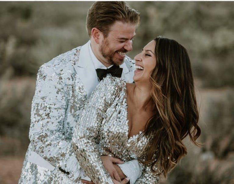 Couple Poses in Glittery Disco Attire | PartySlate