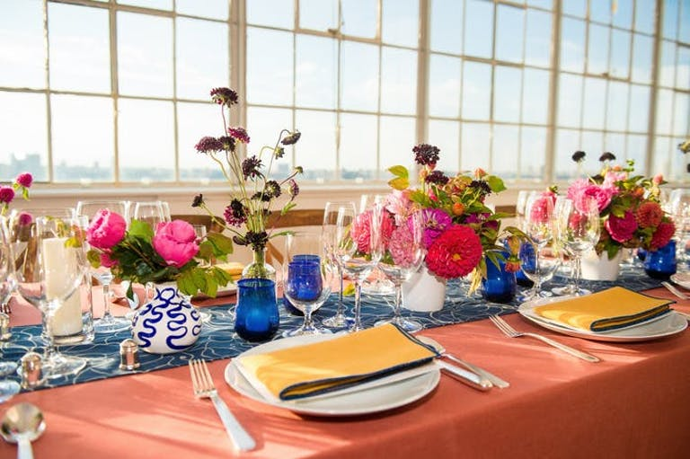 Colorful tablescape with massive paned windows behind.