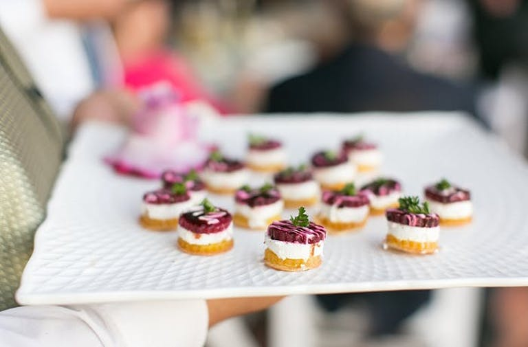 appetizer tray with small bites of purple