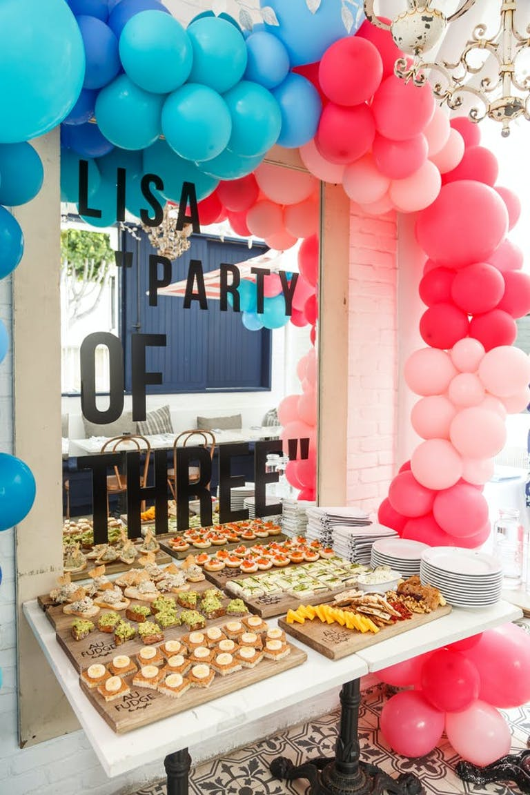 a dessert table with different shades of pink and blue surrounding