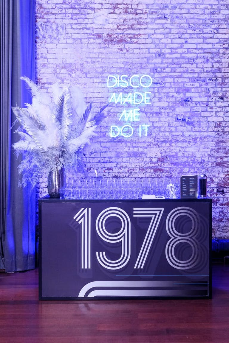 Bar With 1978 Signage for Disco Party | PartySlate