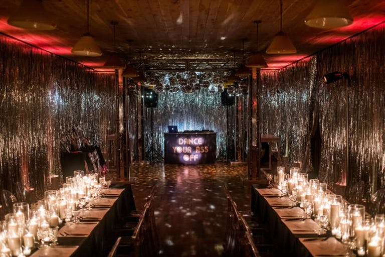 A rectangular room with shimmer draping on all sides for Disco-themed party | PartySlate