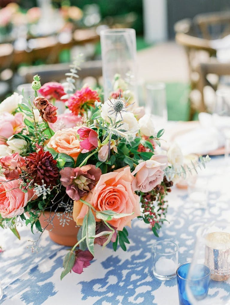 Colorful floral arrangement with blue and white patterned linen