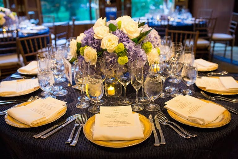 hydrangeas as centerpiece surrounded by white place settings