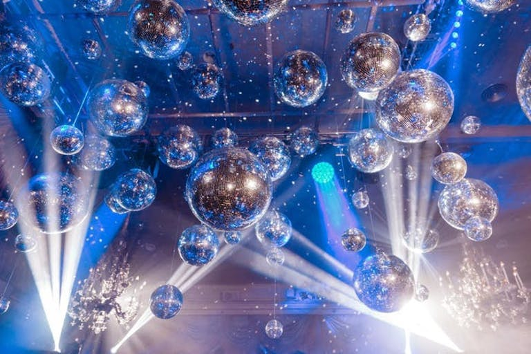 Disco-Themed Party With Disco Ball Ceiling Installation | PartySlate
