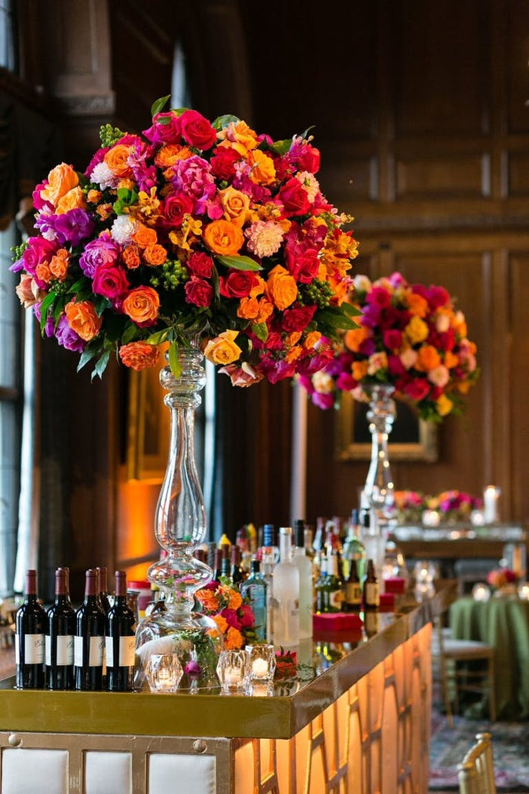 tall transparent vases with red, pink and orange florals