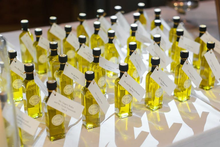 Wedding party favors of mini bottles of olive oil.