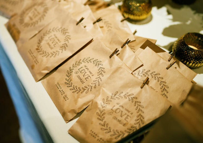 Take-home cookie wedding party favors with custom packaging.