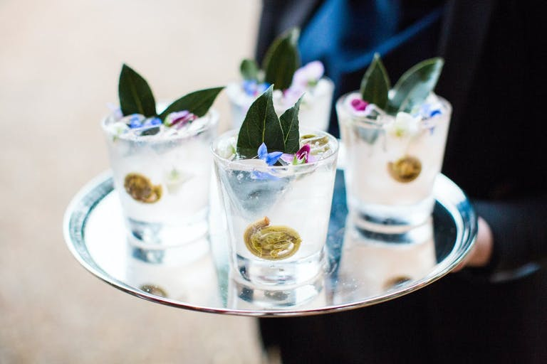 Corporate dinner party with creative cocktails featuring fiddlehead ferns.