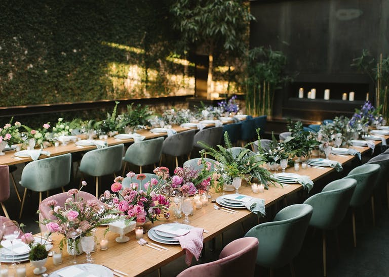 Corporate dinner party with pink floral centerpieces.
