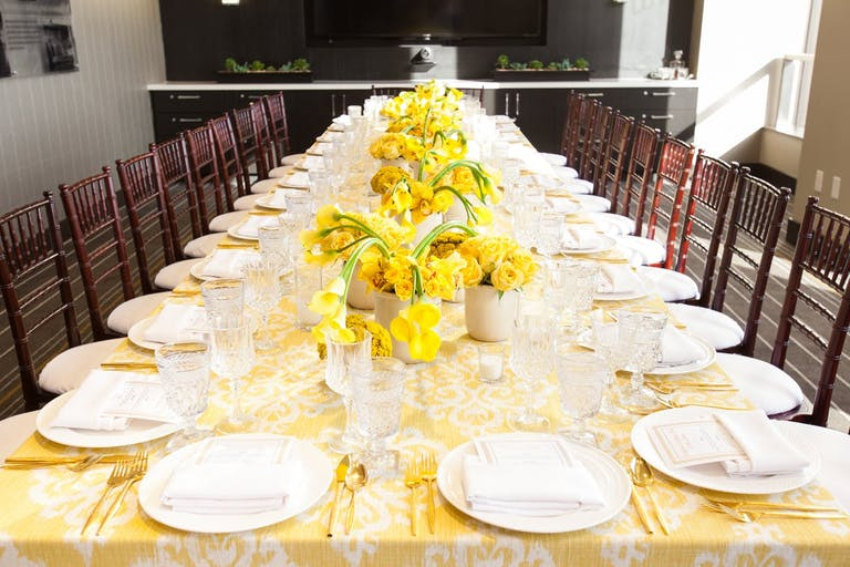 Corporate dinner party with monochromatic yellow décor.