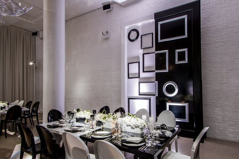 Glamorous corporate dinner party with black and white décor.