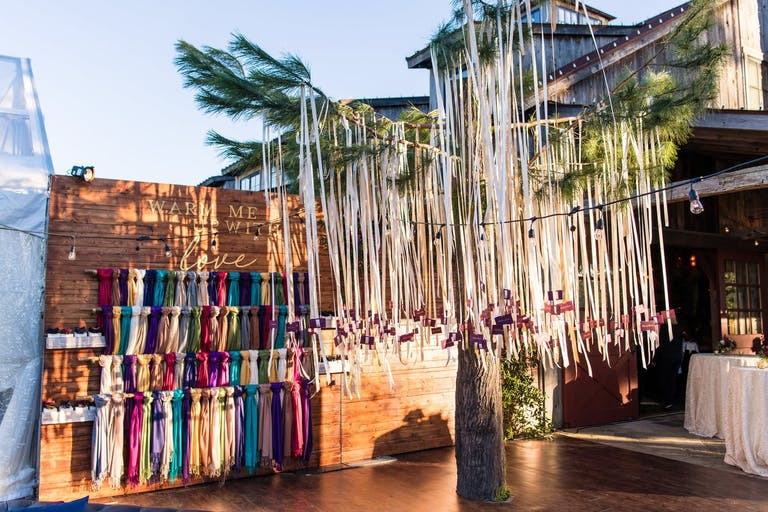 Wedding party favor display of fashion scarves and ribbon décor installation.