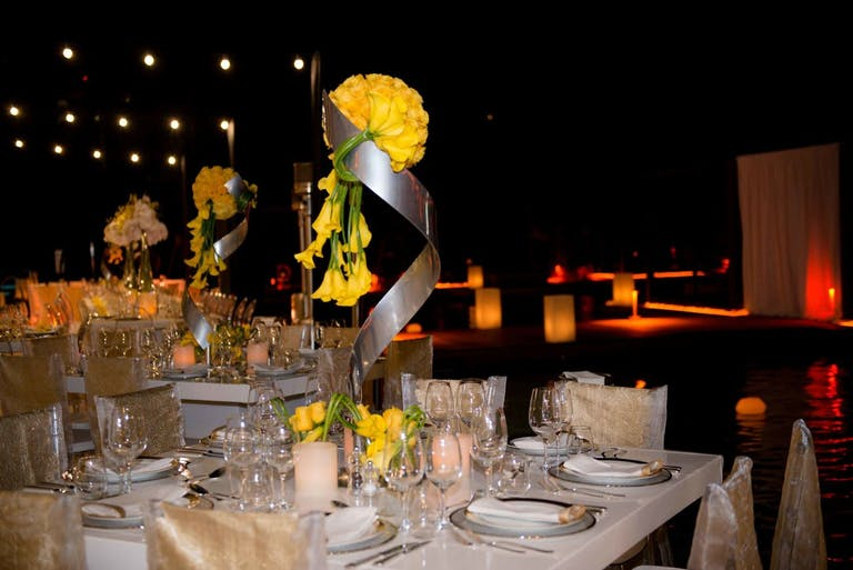 Glamorous corporate dinner party with modern and unique centerpieces.