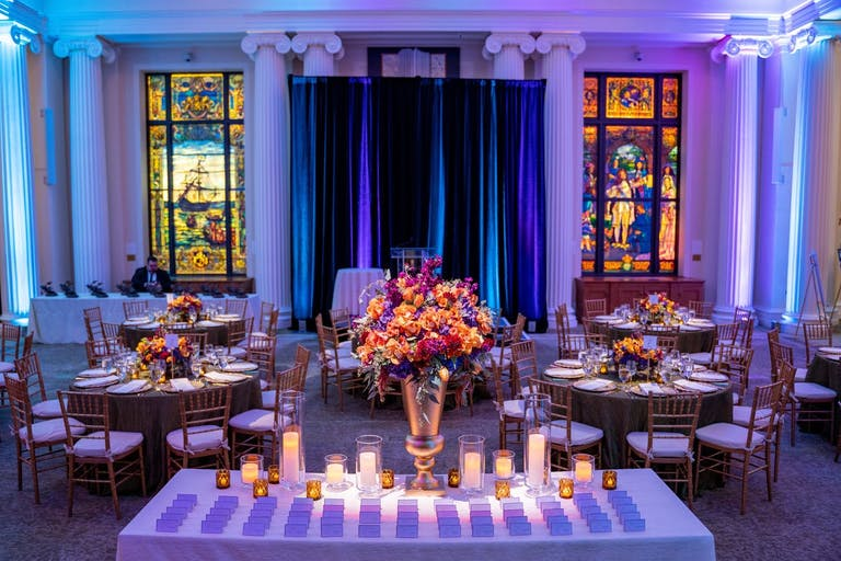 Corporate dinner party with beautiful stained glass windows.