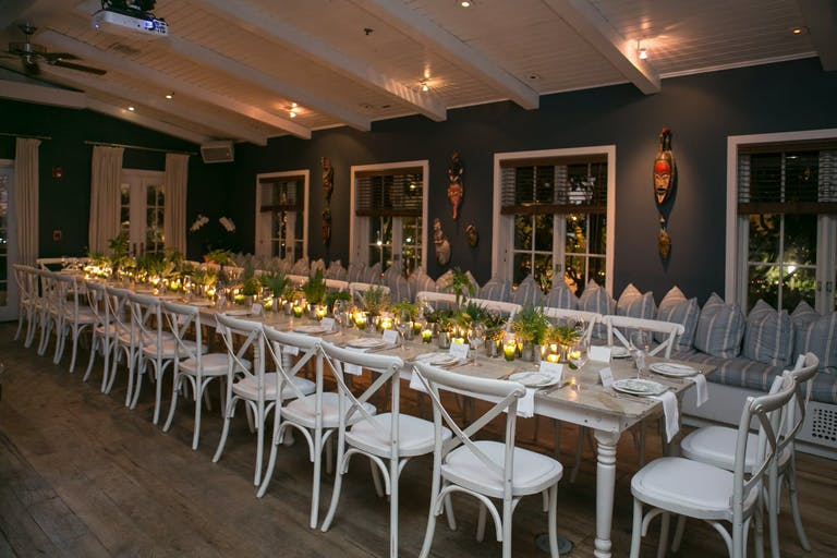 Corporate dinner party with candlelight and greenery.