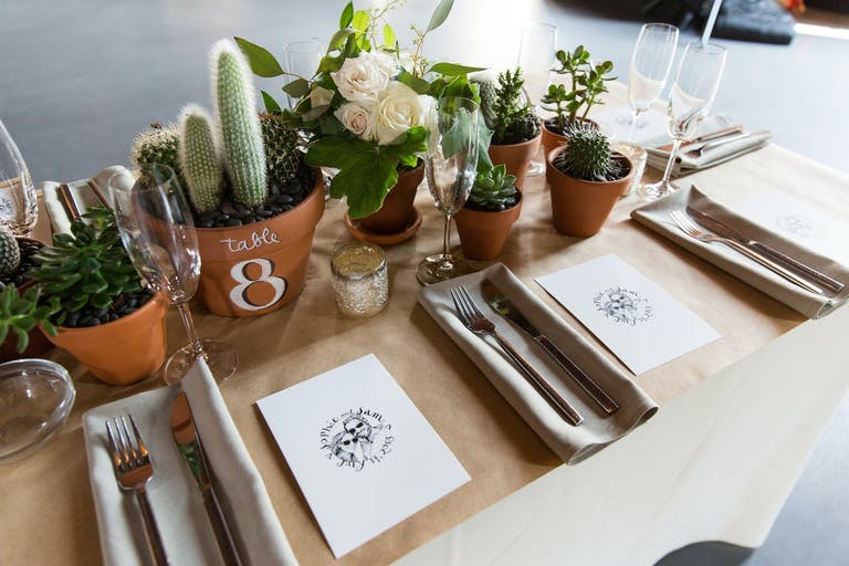 Cacti wedding centerpieces and table numbers.