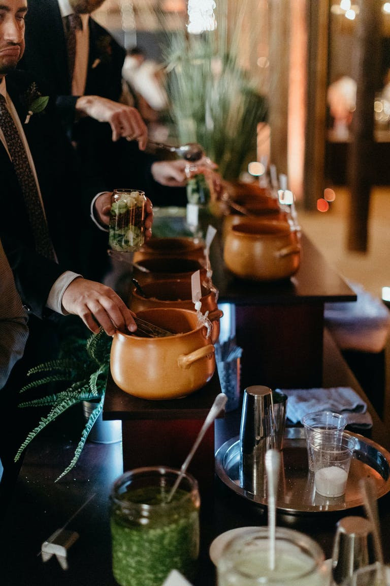 Wedding reception buffet with food served in earthen ware pots.