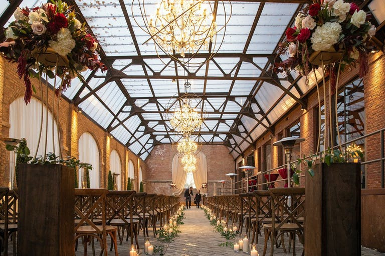 Rustic wedding ceremony with wire-wound chandeliers.