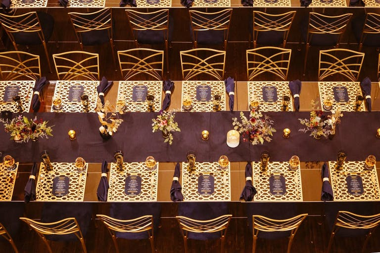 Corporate dinner party with purple and gold décor.
