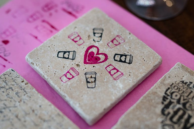 Corporate dinner party where guests made their own coasters.