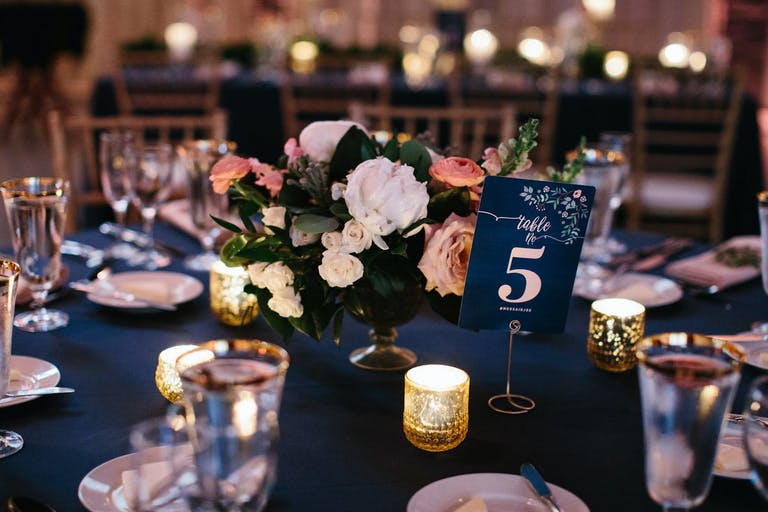 Blue and coral wedding tablescape.