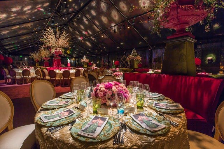 Oscar de la Renta corporate dinner party with dramatic light installations.