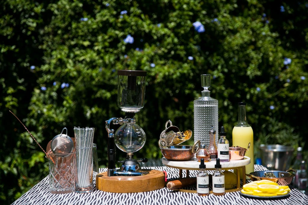 Bartending station vodka transformed into gin and with cannabis infusions.