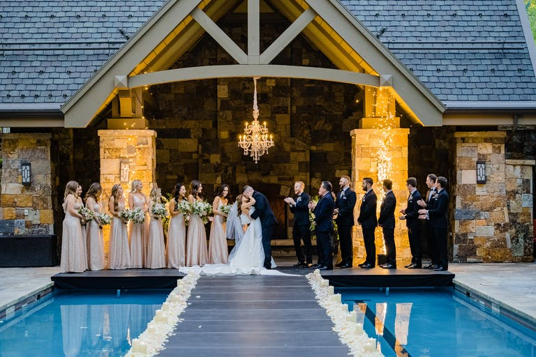 Fairytale Vail Wedding With Unique Wedding Aisle Suspended Over Swimming Pool | PartySlate