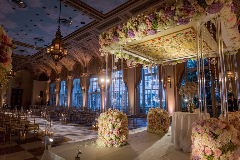Garden Inspired Wedding at The Breakers Palm Beach with Floral Pattern Beneath Chuppah | PartySlate