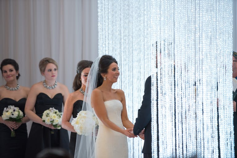 Glamorous All White Wedding at Four Seasons Hotel Chicago with Crystal Chuppah | PartySlate
