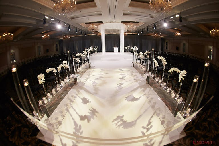 Unique Wedding Ceremony Idea with Floral Shadows on Wedding Aisle | PartySlate