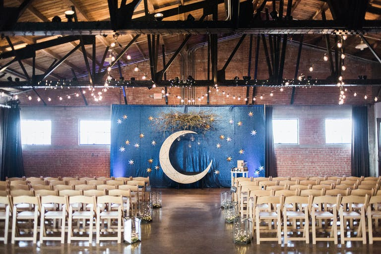 Industrial and Unique Wedding Ceremony at Hickory Street Annex in Dallas, TX with Celestial Backdrop | PartySlate