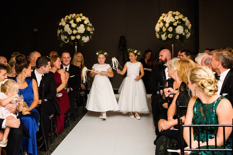 Two Little Girls Carry Unique Pom-Poms Down Wedding Aisle | PartySlate