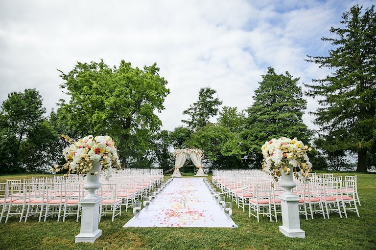 Outdoor Wedding Ceremony With Unique Pink Seat Cushions | PartySlate