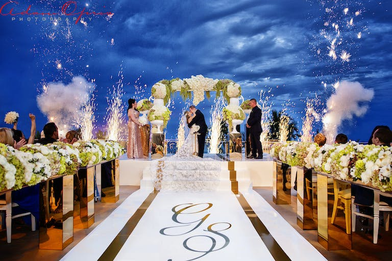 Oceanfront Wedding at Fontainebleau Miami Beach Night Time Ceremony With Cold Fireworks | PartySlate