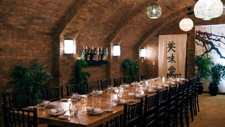 brick curved ceiling with sconces and a long table