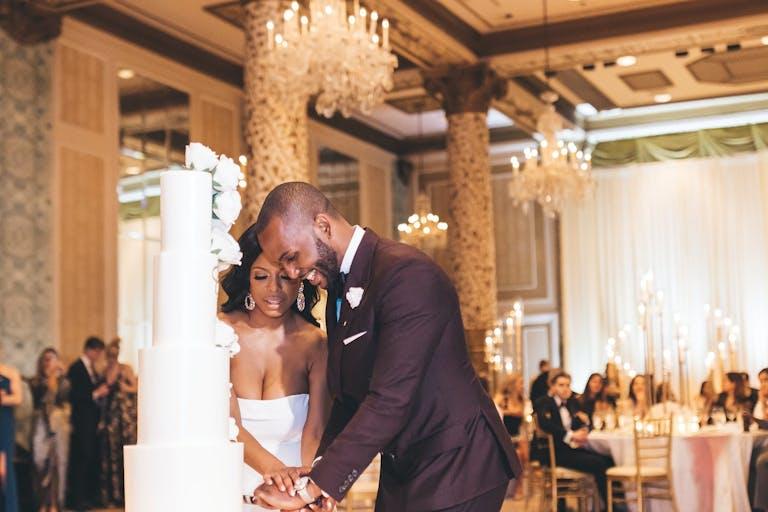 Cake cutting at modern Drake Hotel wedding.