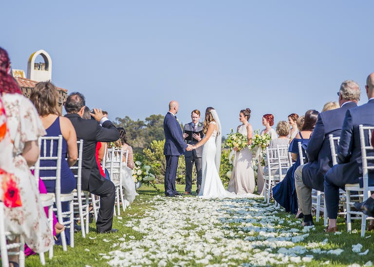 Romantic Oceanview Wedding at The Ritz-Carlton Bacara, Santa Barbara in Santa Barbara, CA With Petals for Wedding Aisle | PartySlate