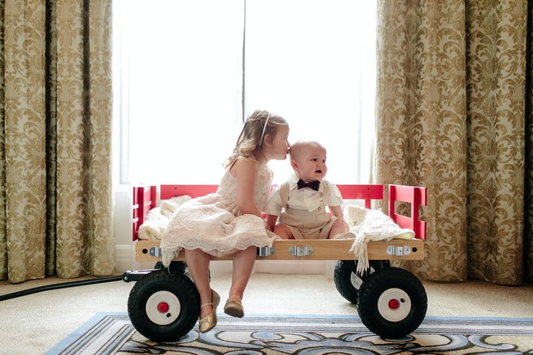 Two Kids Ride in Wagon for a Unique Wedding Ceremony Idea | PartySlate