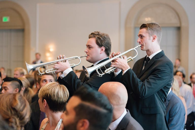 Two Men Play Saxophones Down the Aisle for Unique Wedding Ceremony Idea | PartySlate
