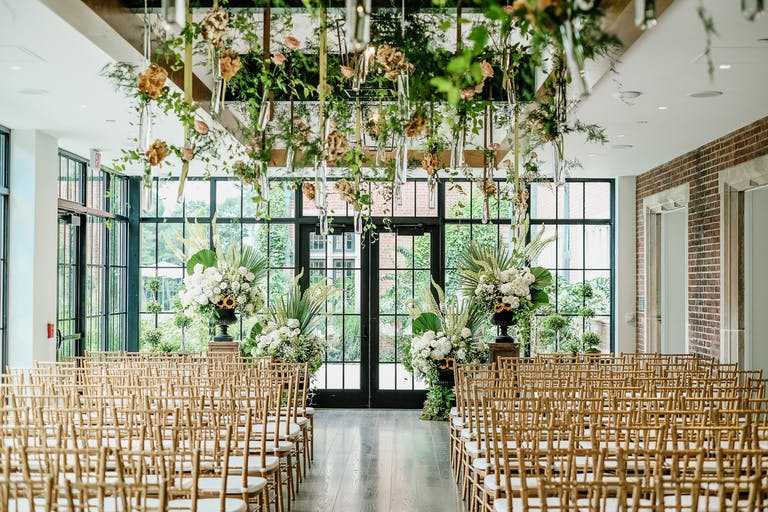 Unique Floral Installation Over Wedding Ceremony Aisle | PartySlate