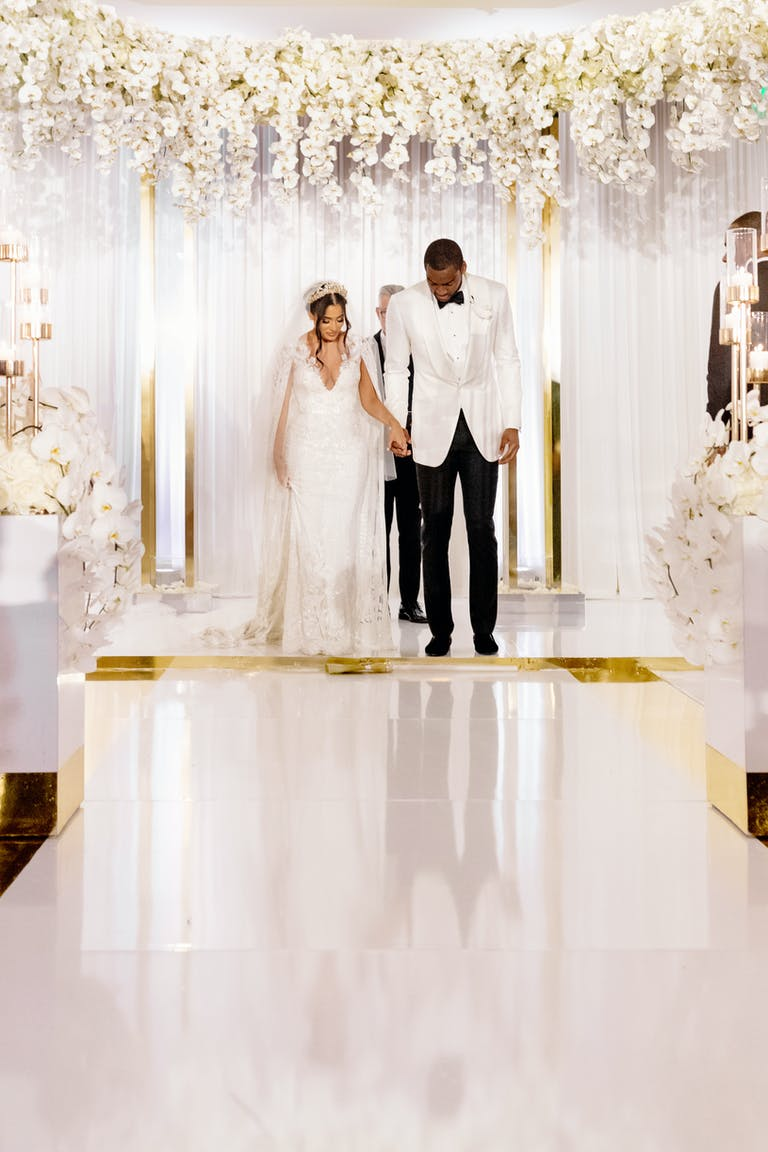 Textured White Layered Wedding at Four Seasons Hotel Miami with Mirrored Wedding Aisle | PartySlate